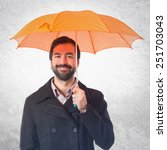 Man Holding An Umbrella Over...