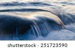 sea water flowing over rock | Shutterstock . vector #251723590