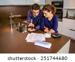 serious young couple reviewing... | Shutterstock . vector #251744680