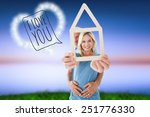 happy couple holding house... | Shutterstock . vector #251776330