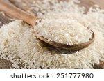 uncooked rice in wooden  spoon .... | Shutterstock . vector #251777980