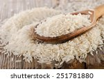 uncooked rice in a wooden ... | Shutterstock . vector #251781880