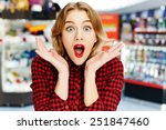 surprised girl in the shop | Shutterstock . vector #251847460