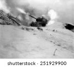 M46 tank of 6th Tank Battalion fires on enemy positions in support of the infantry near Song Sil-li, Korea. In the war tank tactics were developed for the extreme rough terrain. January 10, 1952.