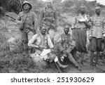 Two Italian soldiers with four wounded barefoot Ethiopian POWs. Italo-Ethiopian War, 1935-36.
