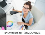 smiling designer using computer ...   Shutterstock . vector #252009028