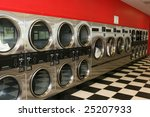 A Row Of Dryers At A Laundromat.