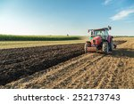 Farmer Plowing Stubble Field...