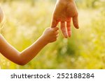 a parent holds the hand of a... | Shutterstock . vector #252188284