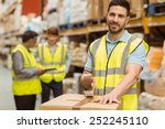 Smiling Warehouse Workers...