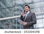 business man with tablet...   Shutterstock . vector #252304198