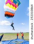 Small photo of Yalutorovsk, Russia - May 24, 2008: Competition of parachutists on landing accuracy on sport airdrome. Paratrooper woman descends