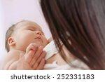 mother and her newborn baby ... | Shutterstock . vector #252331183
