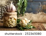 Canned Garlic In Glass Jar And...