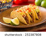 A Plate Of Delicious Tacos Wit...