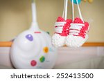 pair of knitted newborn shoes... | Shutterstock . vector #252413500