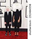 Small photo of LOS ANGELES - FEB 08: Sia & Maddie arrives to the Grammy Awards 2015 on February 8, 2015 in Los Angeles, CA