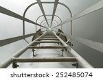 fixed ladder up to the top of... | Shutterstock . vector #252485074