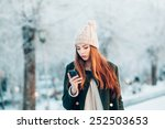 young woman in winter park...   Shutterstock . vector #252503653