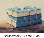 Pile Of Old Blue Books On A...