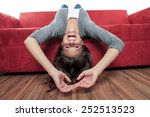 smiling woman with legs up on... | Shutterstock . vector #252513523