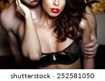 Stock photo sensual brunette woman in underwear with young lover passionate couple foreplay closeup 252581050