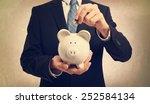 young businessman depositing...   Shutterstock . vector #252584134