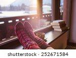 Feet In Woollen Socks By The...