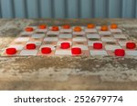 the checkers game on the table | Shutterstock . vector #252679774