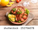 Tasty Baked Fish On Plate On...