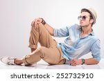 cool fashion man lying on the... | Shutterstock . vector #252732910