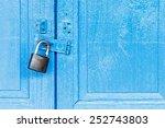 Key Lock On Blue Wooden Door.