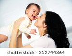 happy mother with adorable baby | Shutterstock . vector #252744364