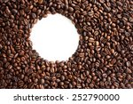 Coffee beans background with empty white circle for text - stock photo