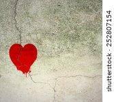 Cracked Red Heart On Concrete...