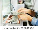 female hand with money in cash...   Shutterstock . vector #252812953
