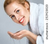 young woman washing face with... | Shutterstock . vector #252923020