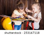 two little girls making very... | Shutterstock . vector #253167118