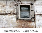 Small Window Of Old Rusty Barn