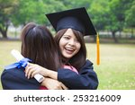 young female graduate hugging... | Shutterstock . vector #253216009
