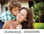 spring portrait of mother and... | Shutterstock . vector #253255090