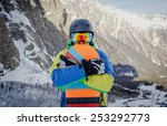snowboarder hold snowboard on... | Shutterstock . vector #253292773