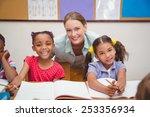 cute pupils and teacher smiling ... | Shutterstock . vector #253356934