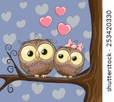 Two Cute Owls Is Sitting On A...