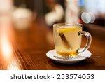 herbal tea on wooden table in... | Shutterstock . vector #253574053