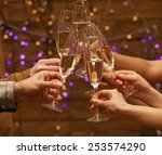 clinking glasses of champagne... | Shutterstock . vector #253574290