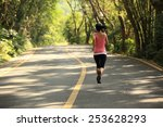 young fitness woman running at... | Shutterstock . vector #253628293