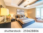 Stock photo modern bright bedroom interior with designer pillows in a luxury house hotel 253628806