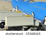 Airplane at the airport while loading - stock photo
