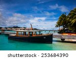 a boat at a dock on the beach...   Shutterstock . vector #253684390